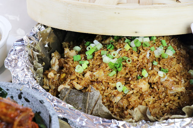 Fried Rice with Chicken Cube in Bamboo Basket and Lotus Leaf