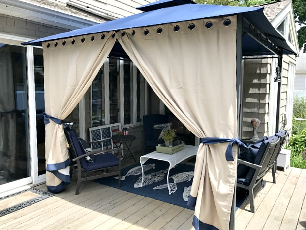DIY gazebo curtains on a summer deck