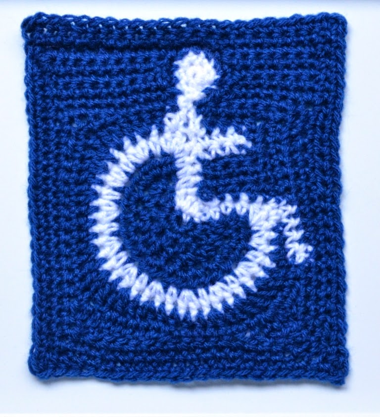 My crocheted international access symbol (white wheelchair symbol on a blue background)  without a border. I used a freeform technique to create the shapes.