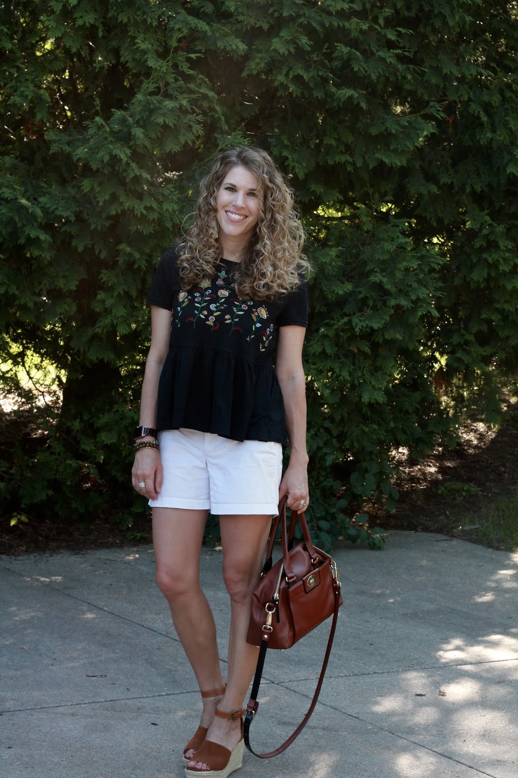 black embroidered peplum top, white shorts, Steve Madden wedges, Kate Spade cognac crossbody bag,