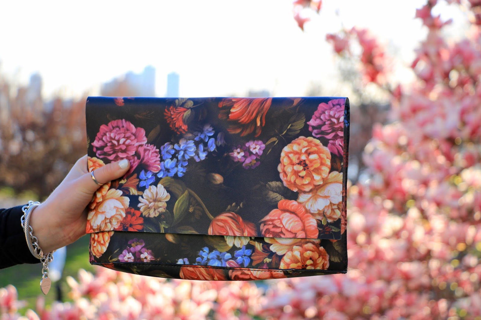Nyc fashion blogger Kathleen Harper wearing an Anthropologie floral clutch