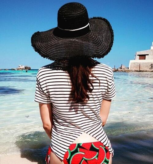 Isla Mujeres Cancún Playa norte riviera maya playa mujer sobrero playa sandias