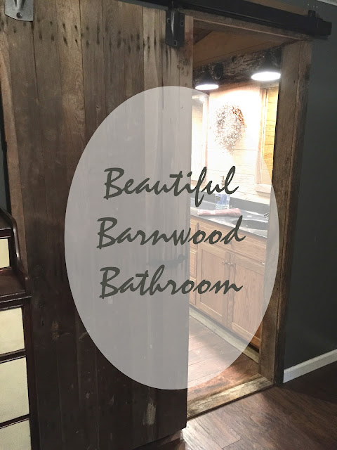 beautiful barnwood bathroom with reclaimed barn door
