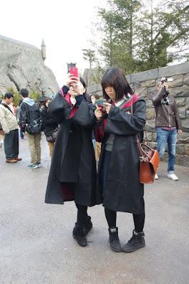 Japanese girls wearing Hogwarts uniforms at USJ