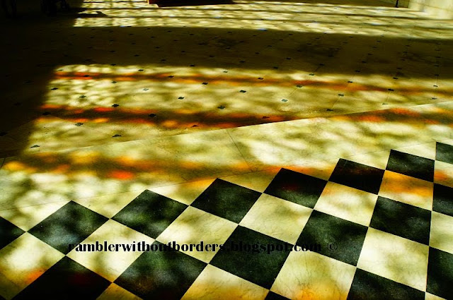Shadow cast on the floor by light through stained glass window, Sainte Chapelle, Vincennes Castle, Paris, France