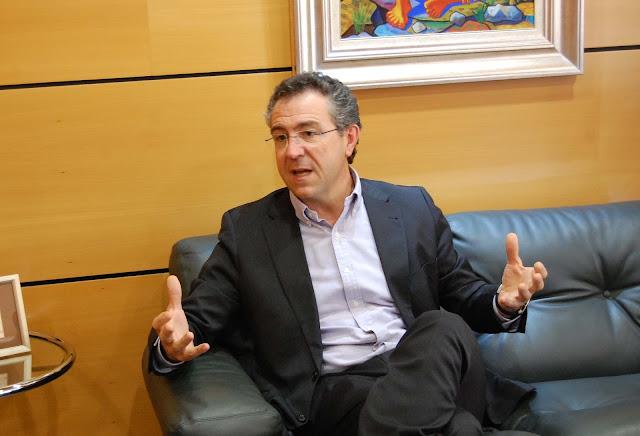 La opini n de emilio ruiz for Cajamar valencia oficinas