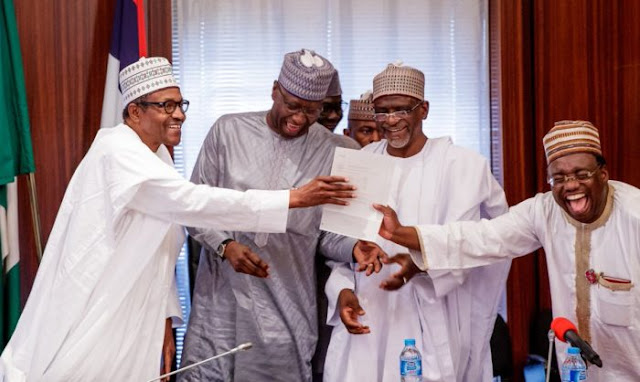 Buhari, Mustapha, Adamu Adamu and Chief of Protocol, Ambassador Abdullahi Kazaure share in the excitement of the moment.