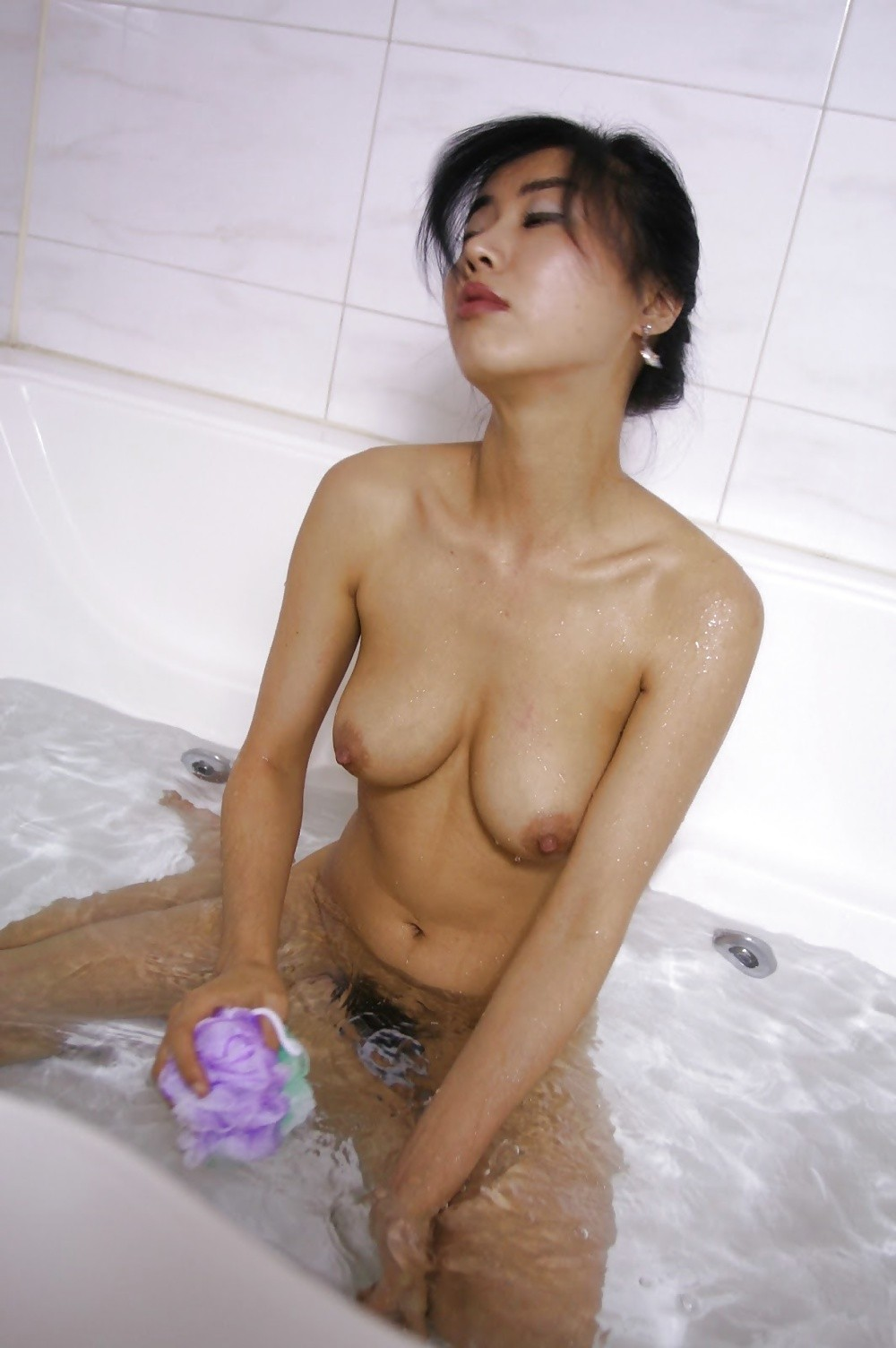 Nude asian girls bathtub seems
