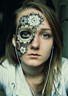 steampunk special fx makeup for halloween or cosplay. face paint of gears ripping through skin.