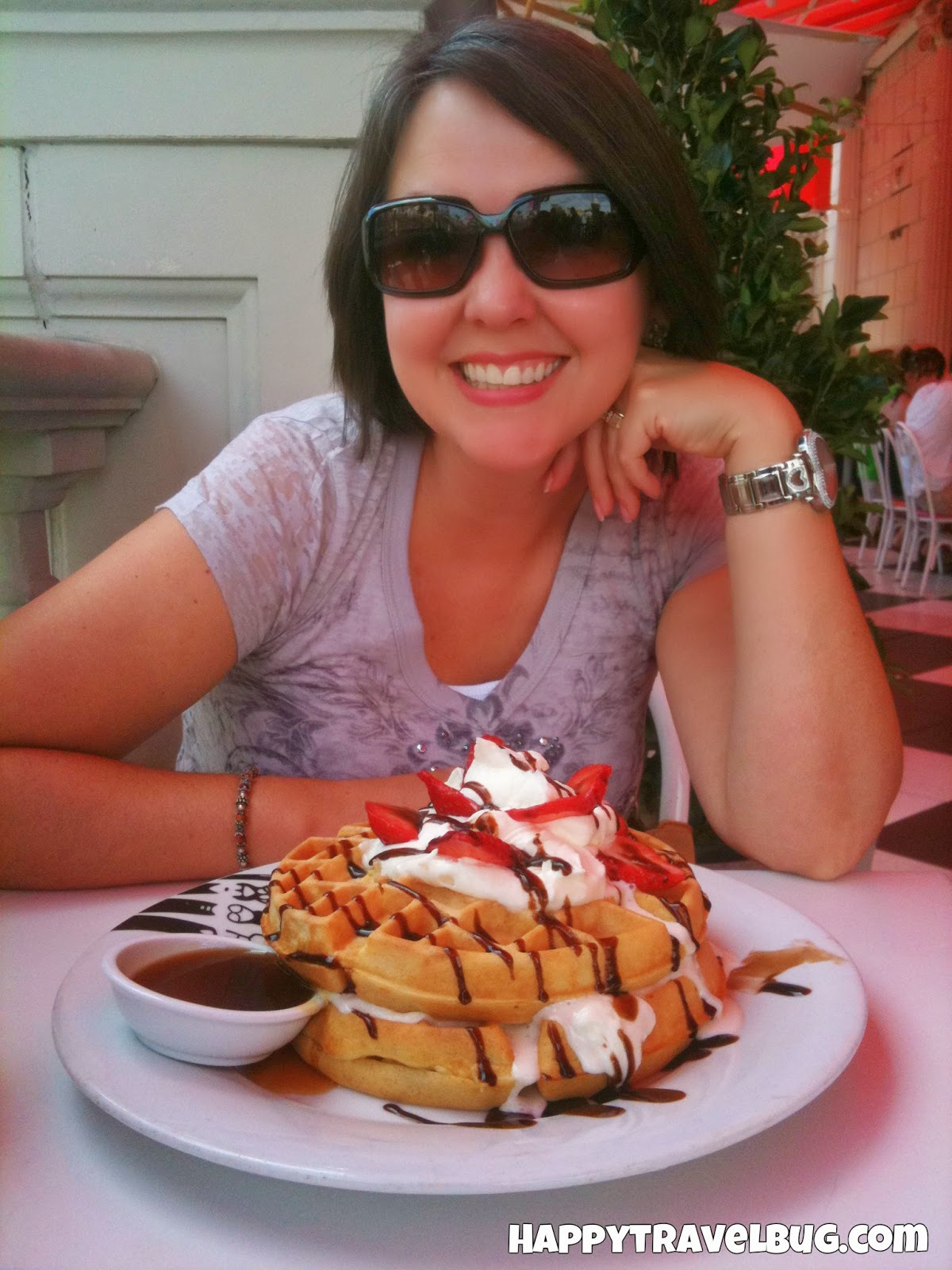 The {Happy} Travel Bug eating waffles at Serendipity 3