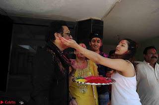 Govinda celeting Holi with His family wife daughter 013.JPG