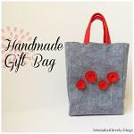 http://letsmakeitlovely.blogspot.com/2014/07/felt-gift-bag.html