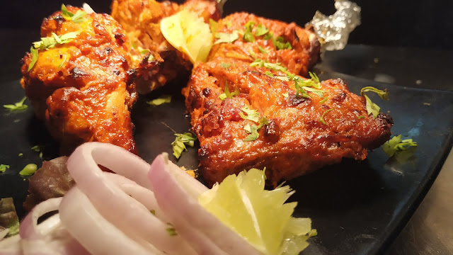 Reddish brown colour chicken leg and breast cooked in Tandoor Food Recipe Dinner ideas easy dinner Recipe