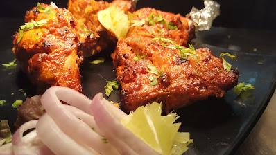 Garnished Tandoori chicken pieces for Tandoori chicken recipe