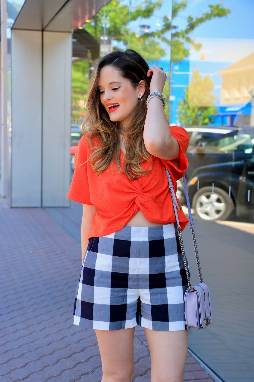 Nyc fashion blogger of Kat's Fashion Fix, Kathleen Harper, wearing an orange twist crop top from Zara in 2018