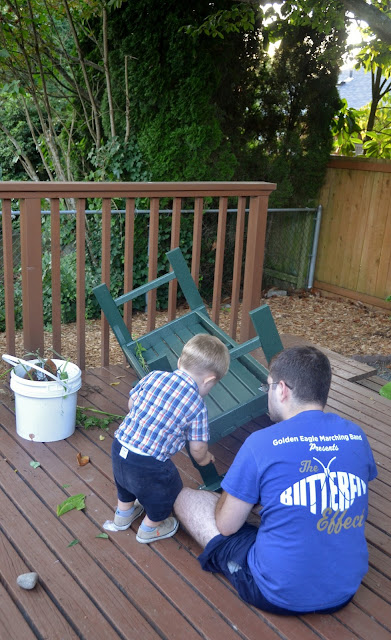 toddler and his dad building a bench