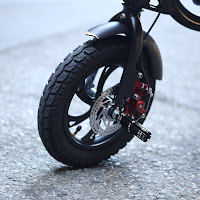 Air-filled tires & foot-rest pegs on SwagCycle E-Bike