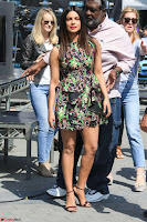 Priyanka Chopra looks super cute in happy mood wearing a short flower print dress in Hollywood 005.jpg
