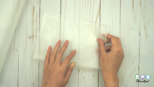 Folding sheets of wax paper in half.