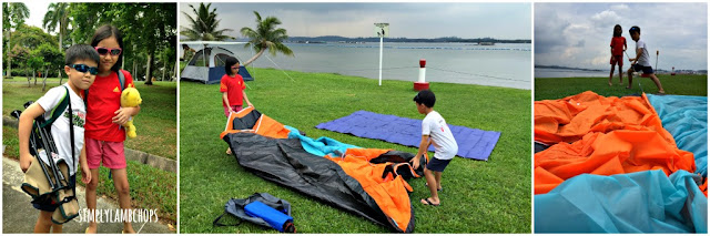 Kids help to pitch tent.