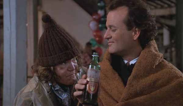 Bill Murray talking to Anne Ramsey in Scrooged 1988 movieloversreviews.filminspector.com