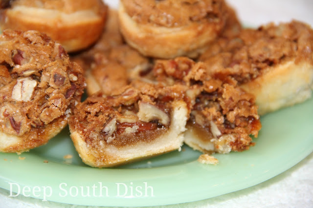 Little bite sized pecan desserts, made with a cream cheese pastry crust baked with a brown sugar based pecan filling.