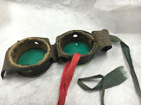 back of green goggles