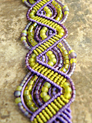 Beaded micro macrame bracelet in purple and green.
