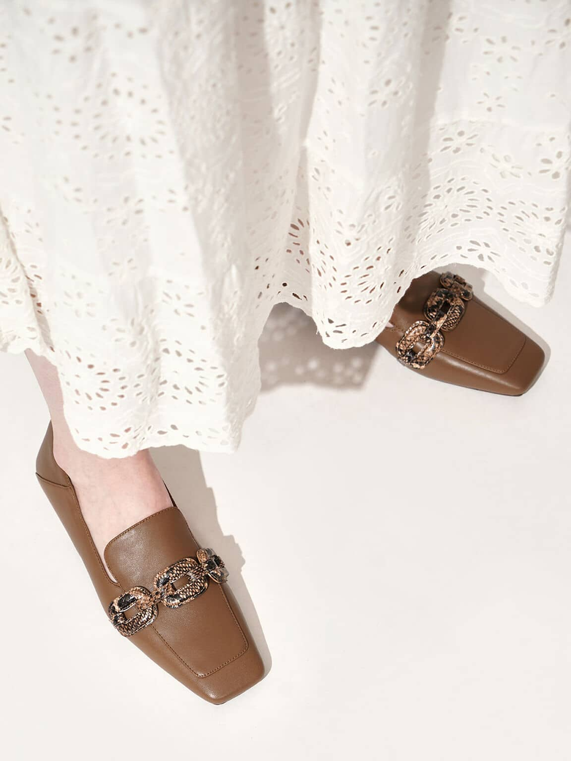leather snake print loafers
