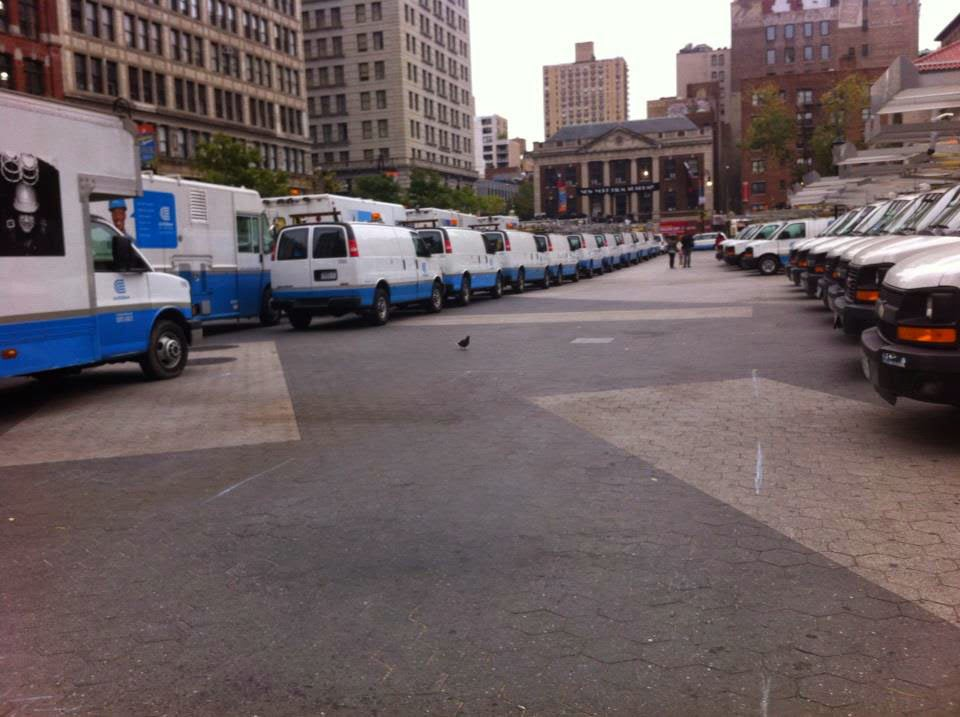 Utility trucks lining the streets of Union Square