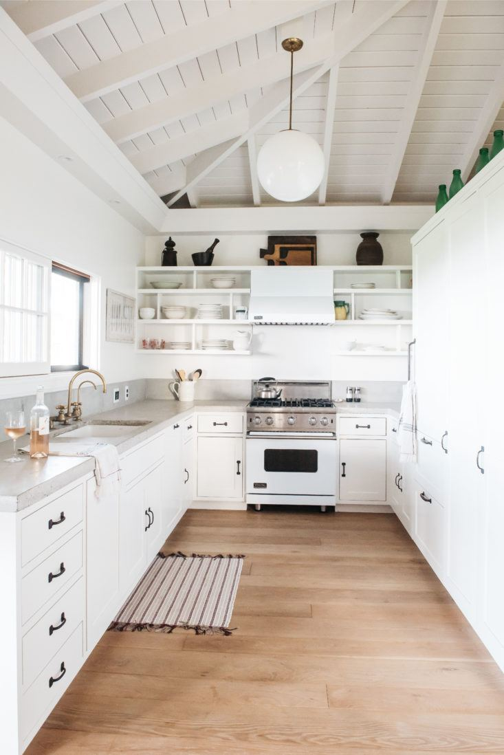 Gorgeous white kitchen in beautiful oceanfront cottage on Maui - found on Hello Lovely Studio