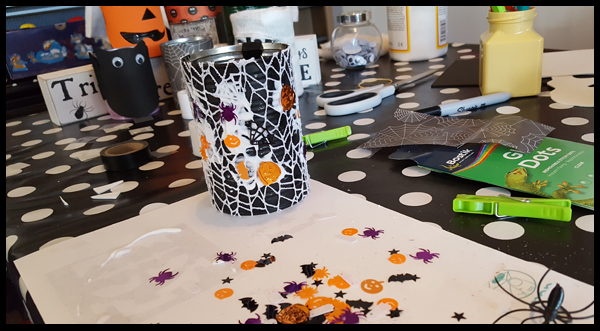Decorating tin cans for Halloween