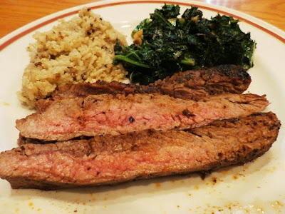 Flank Steak on a plate with rice and kale