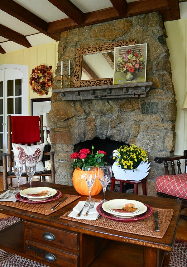 Rustic living room with stone fireplace and table setting on coffee table