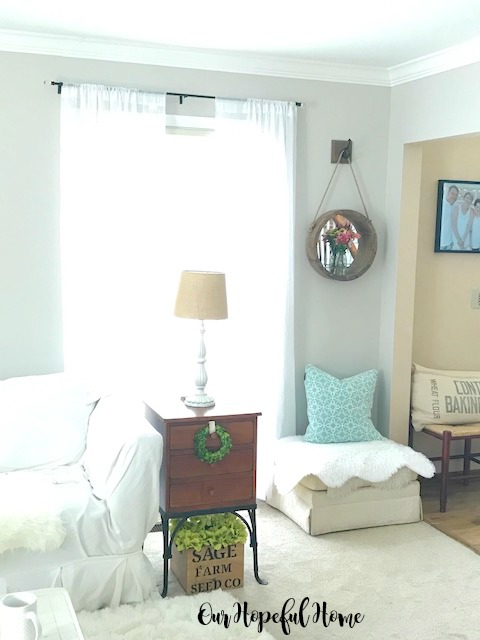 round wooden farmhouse mirror vintage milk bottle vase fresh cut flowers living room decor