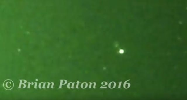 Something odd appears next to a Star UFO in night vision