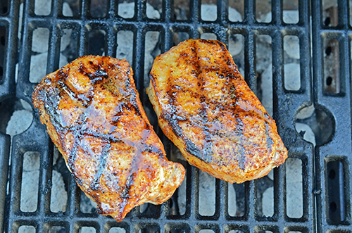 Boneless pork chops with rub and butter  on Char-Broil gas to coal grill