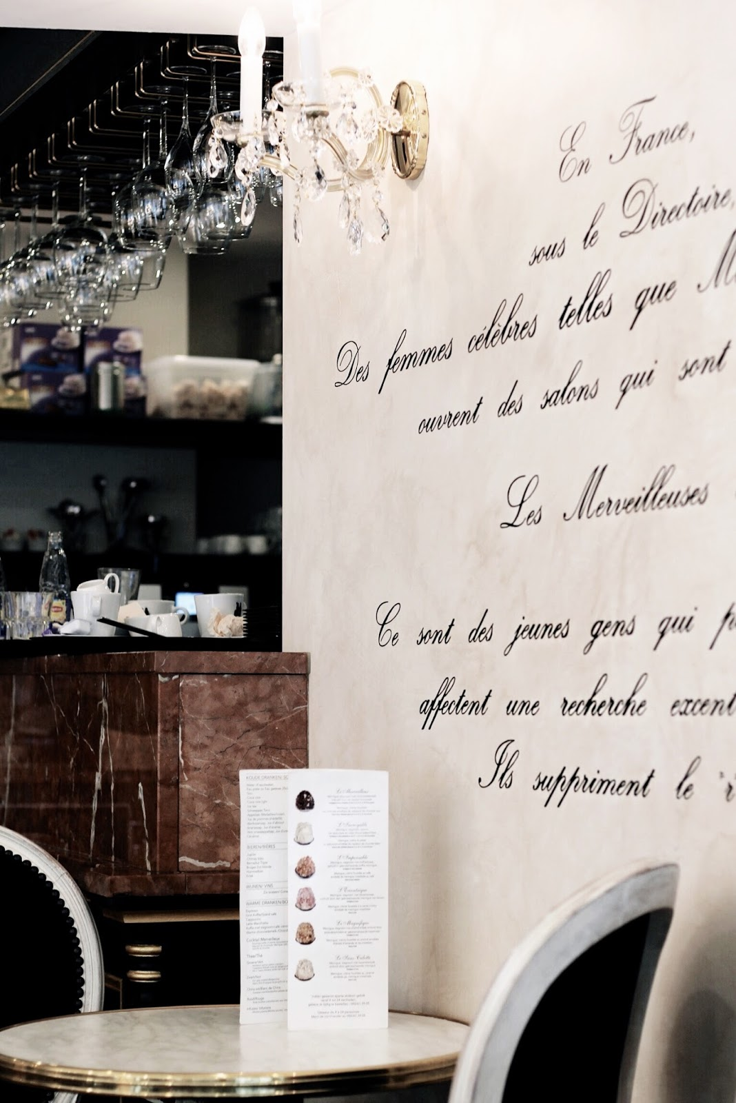 Italic font writing on cafe restaurant wall