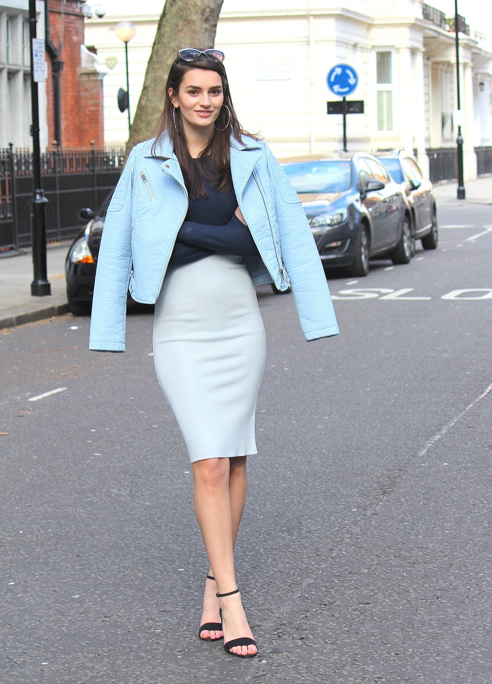 peexo fashon blogger wearing midi dress and crop top and leather jacket in pastel blue for spring