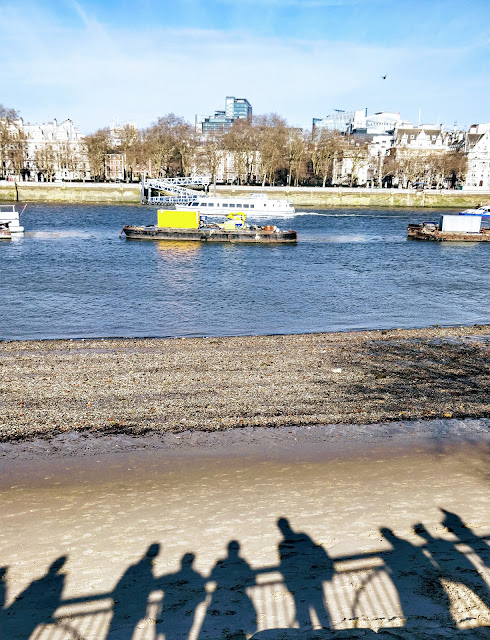 cropped pic of shadows of people along Thames