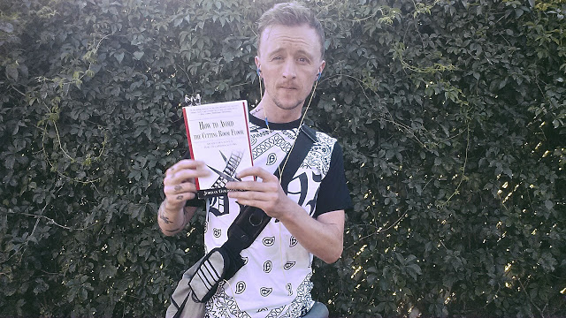 Paul Cram holding book for acting