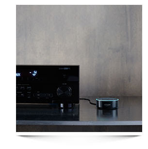 image of amazon echo dot connected to a receiver