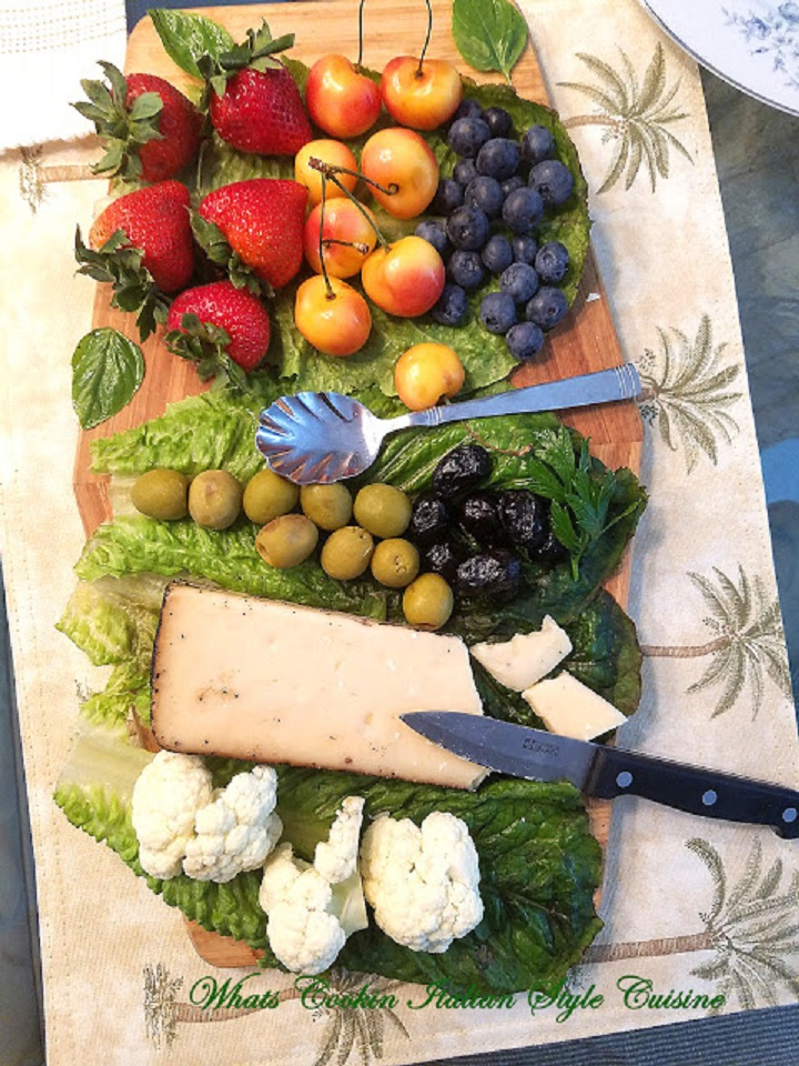 This is a cheese, wine, fruit, olives and board built with all kinds of appetizers to include