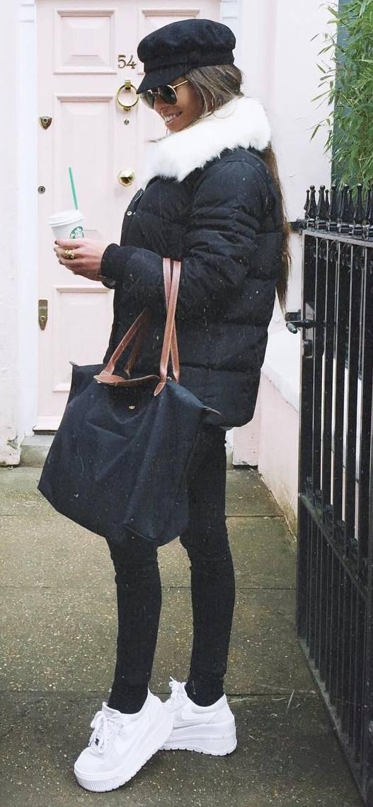 incredible winter outfit / hat + black jacket + bag + skinnies + white sneakers