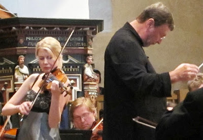 An orchestra performing the Sibelius Violin Concerto,