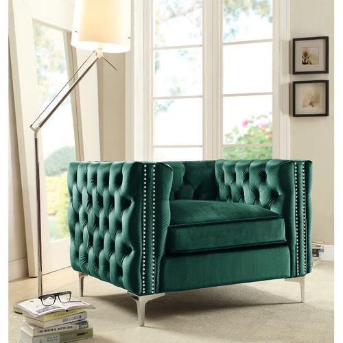green velvet tufted chair with nailhead trim