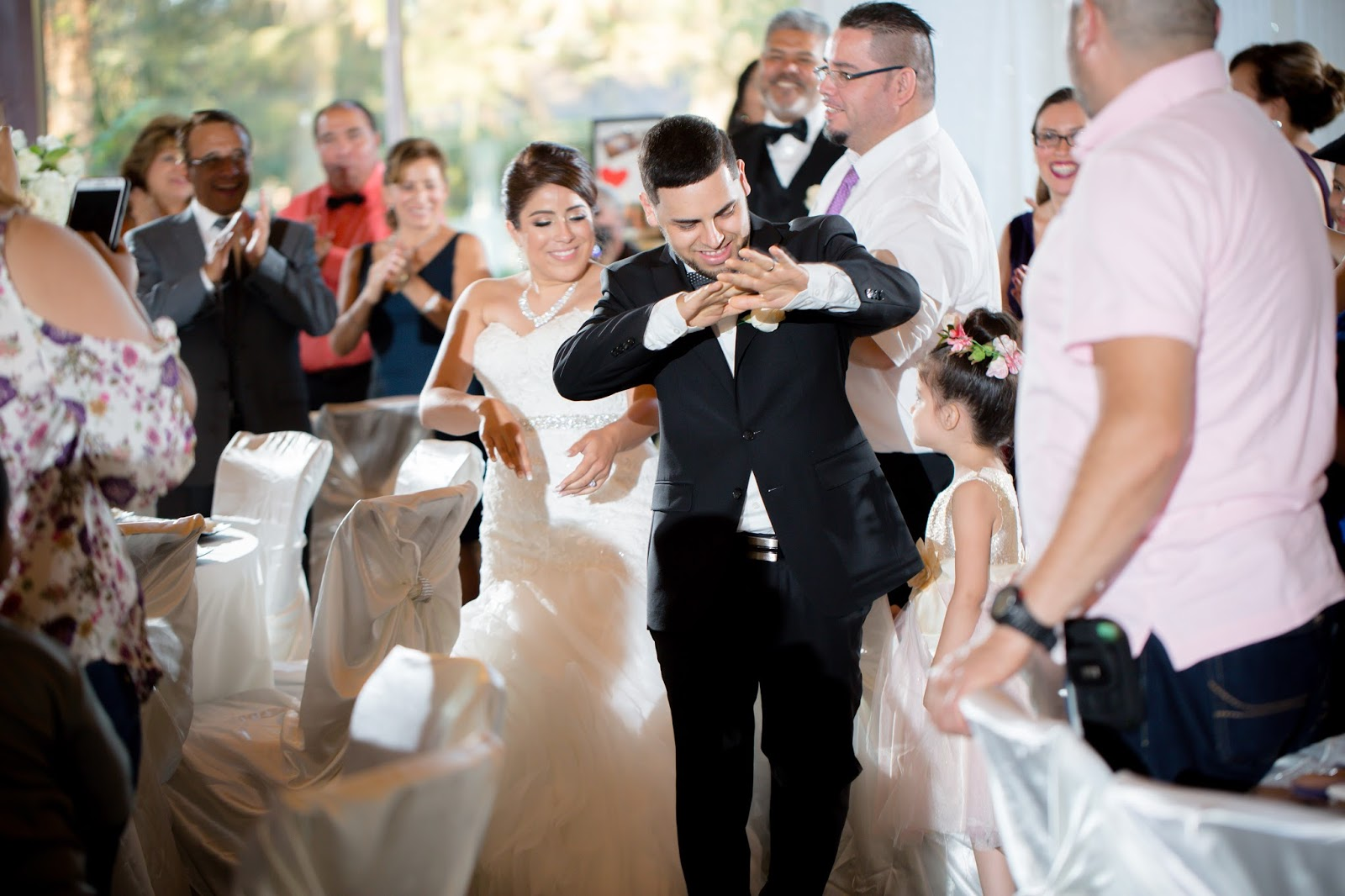 Bride and Groom dance their way through guests