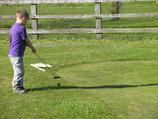 child size golf course with putting green