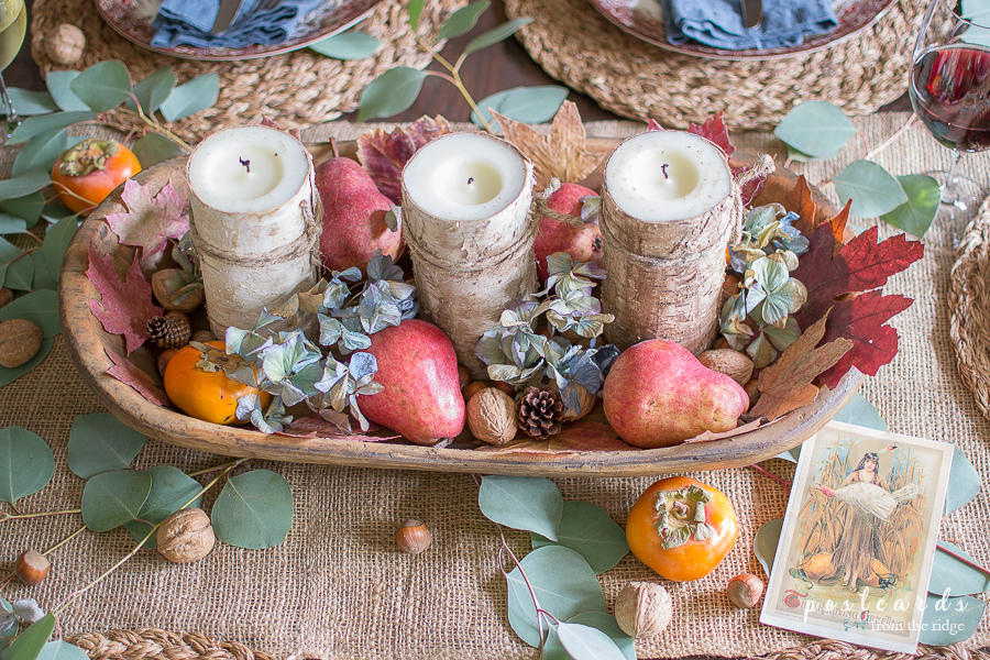 Thanksgiving centerpiece with fruits and nuts in wooden bowl