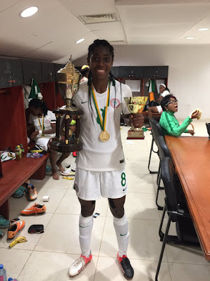 Oshoala poses with the AWCON trophy